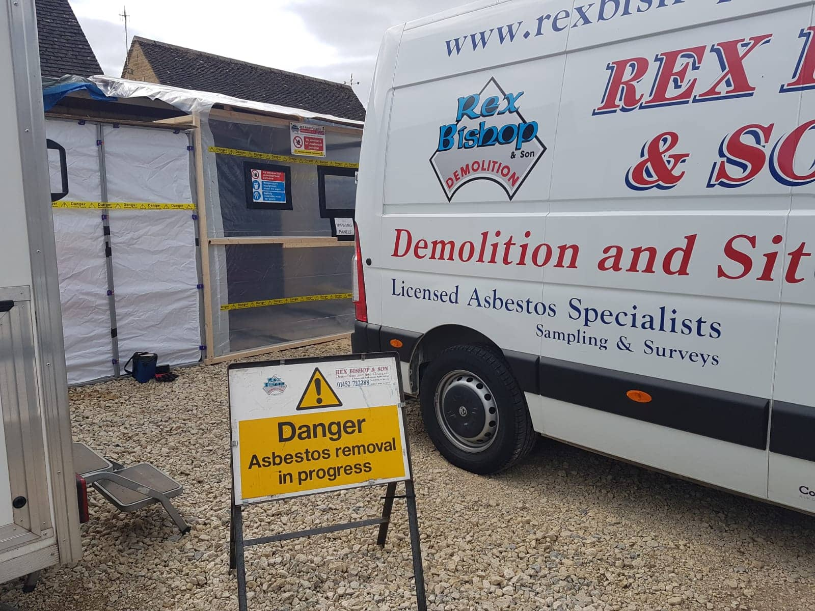 Rex Bishop & Son van outside a garage having asbestos removed