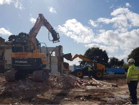 Site being cleared by two diggers