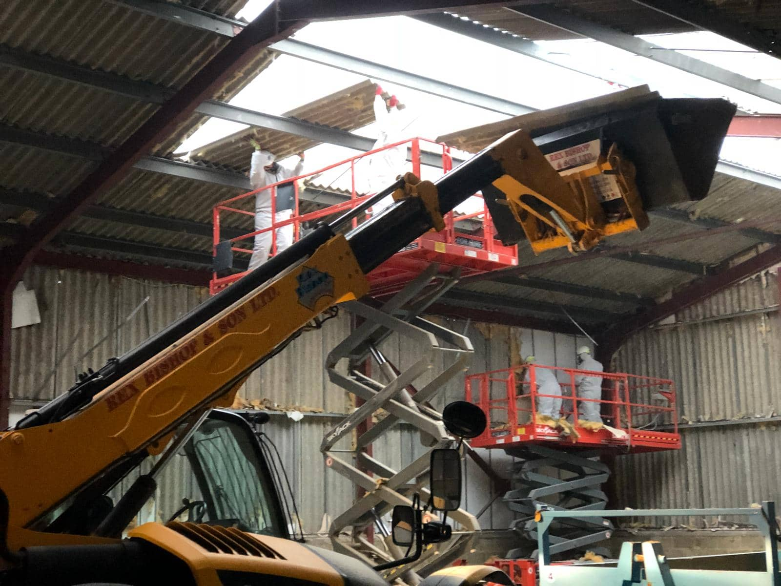Worker getting lifted by machinery