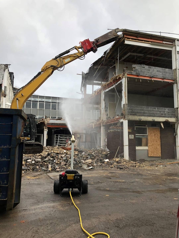 Digger demolishing an empty building